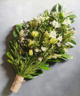 green-funeral-flowers-black-shed