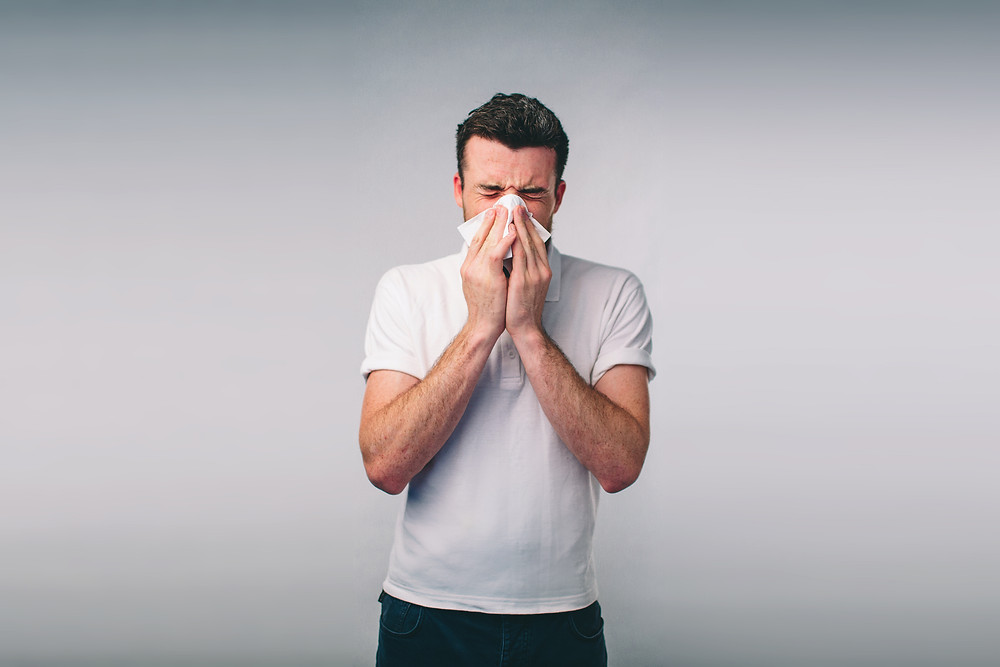 Allergies cause sneezing, runny nose, and itchy/watery eyes.r