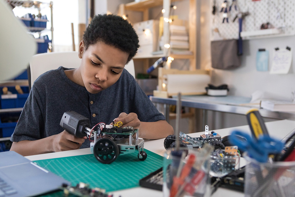 A student works on a robotic toy as part of his STEM education