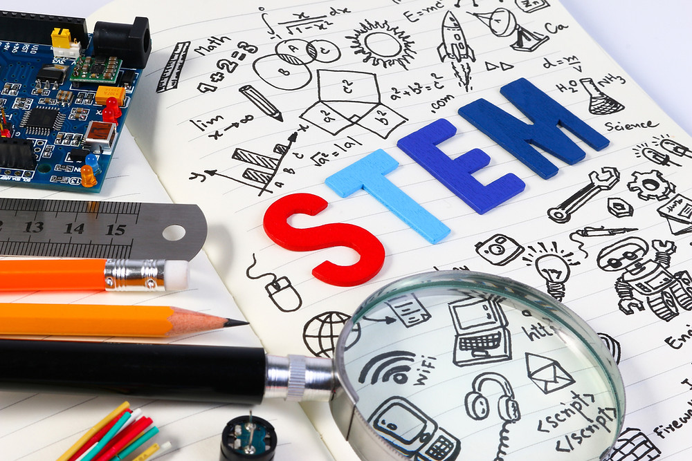A sheet of paper with STEM education focus and academics, as well as tools and school supplies.