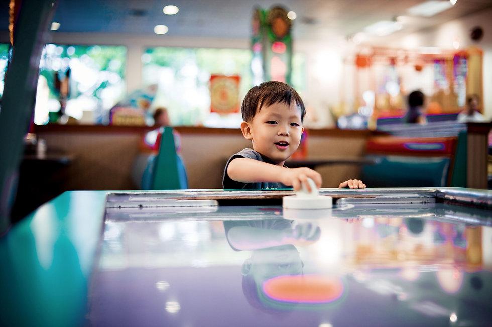 Boy Playing Air Hockey