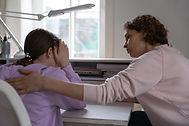 128247654-worried-mother-talking-comfort