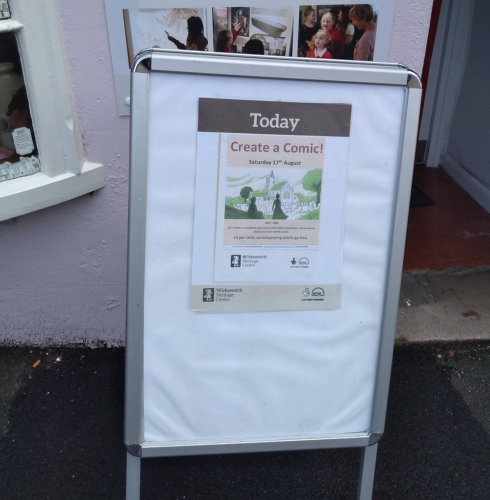 An image of a signboard outside Wirksworth Heritage Centre reading 'Today, create a comic!'