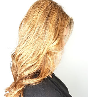 Long layered haircut with buttery blonde highlights