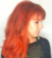 Long layered haircut with orange red haircolor