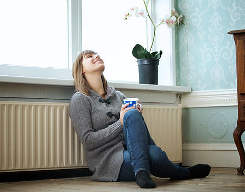 Portrait of an Attractive Young Woman Relaxing at Home.jpg