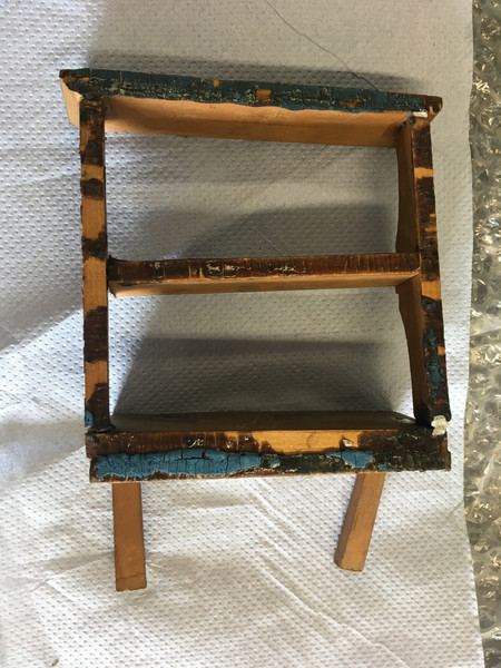 Old wood glue on shelf - picked off with a scalpel before fixing to house