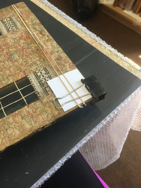 Adhering the wallpaper to the door
