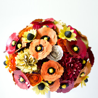 book themed wedding bouquet in warm tones of red, orange and yellow | handmade by Anthology On Main