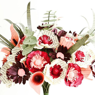 art deco inspired book bouquet with a mix of poppies, anemones, roses, lily grass, eucalyptus, calla lilies, and daisies   handmade by Anthology On Main