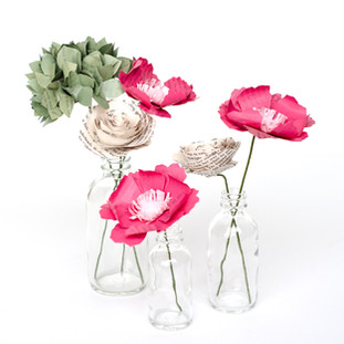 wedding centerpieces | book page flowers with bud vases | custom book themed wedding flowers by Anthology On Main