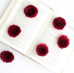 wedding table decor | stemless book roseswedding centerpieces | book page flowers with bud vases | custom book themed wedding flowers by Anthology On Main