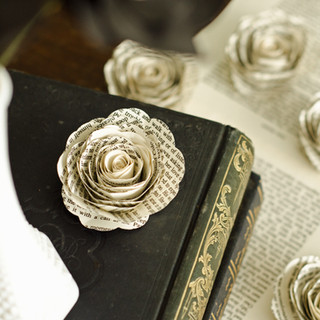 stemless book page roses for table decorations, made from your choice of book | custom book themed wedding flowers by Anthology On Main