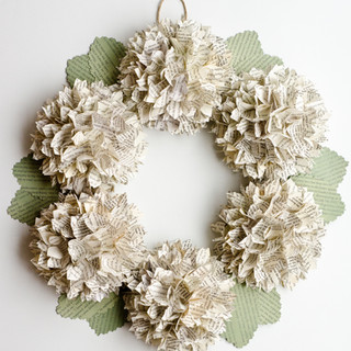 hydrangea wreath made from your favorite bookwedding centerpieces | book page flowers with bud vases | custom book themed wedding flowers by Anthology On Main