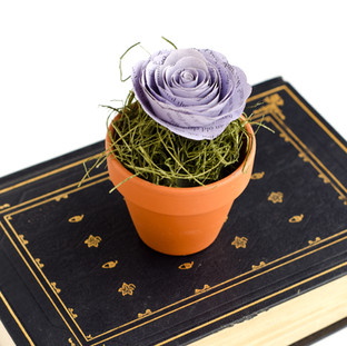 wedding guest favors | book page rose in flower pot | wedding centerpiece | custom book themed wedding flowers by Anthology On Main