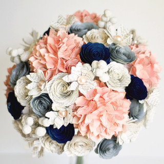 winter bridal bouquet in peach, ivory, navy and gray; made with hydrangeas, daisies, brunia berries, and roses | book themed romantic wedding | handmade by Anthology On Main