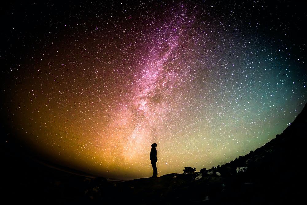 man watching at sky stars in night