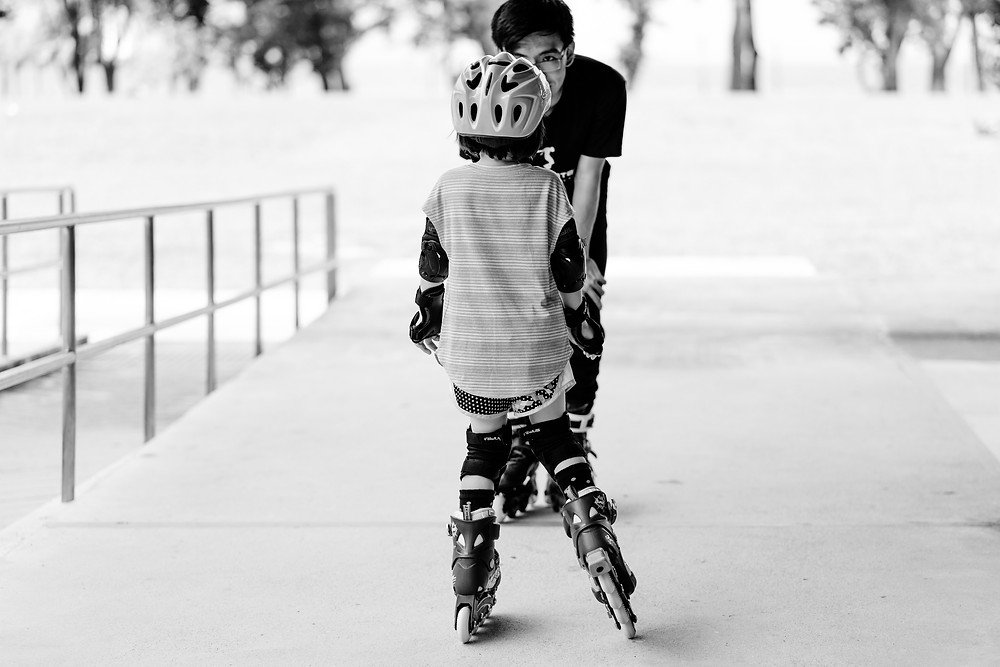 trainer teaching a child for skating