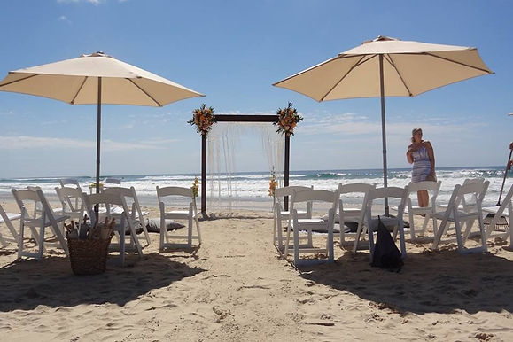 Coolum beach wedding - timber arch - macrame hanging