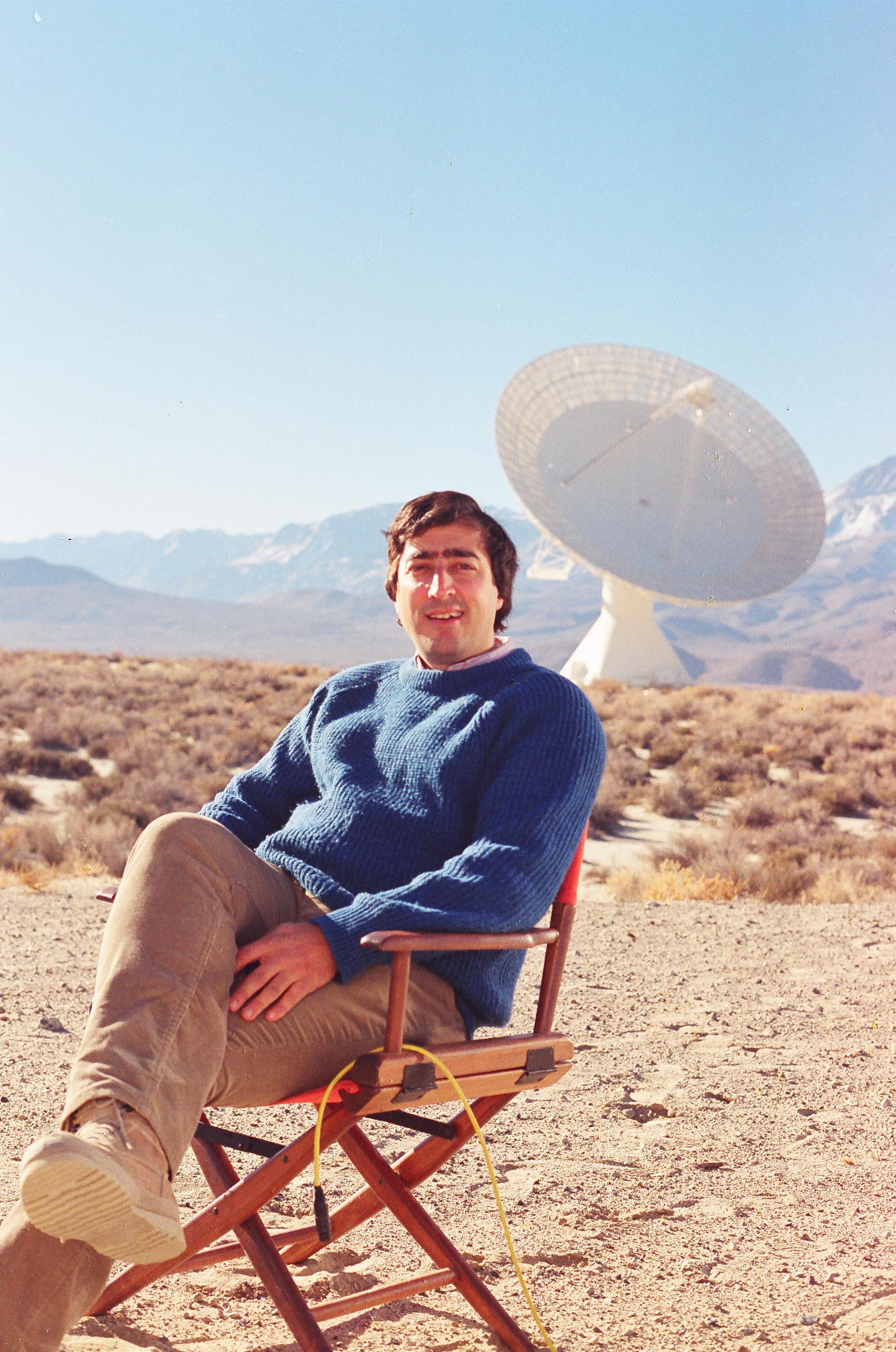 Elliott at radio telescope in California
