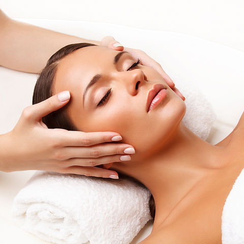Face Massage.jpg  Close-up of a Young Woman Getting Spa Treatment.jpg