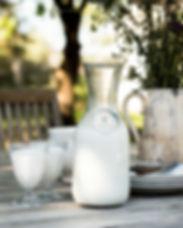 Rauwe geitenmelk melkfles