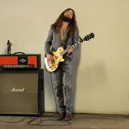 Grey suit and Les Paul Goldtop? Might as well be a bullseye.