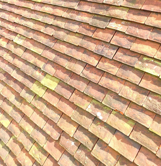 Aerial still image of clay roof tiles on