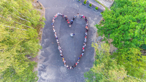 Wedding guests lined up in the shape of a heart