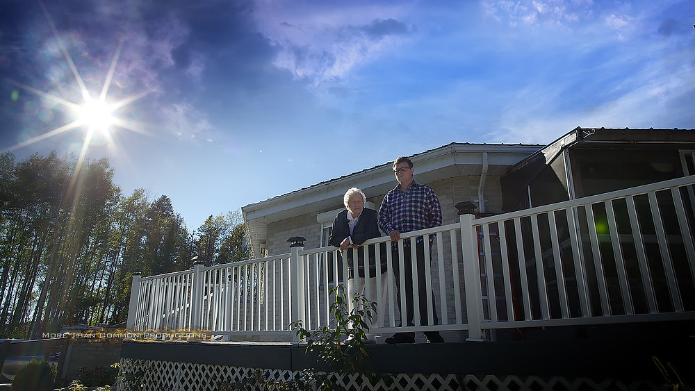 Ruby and Grandson outsite her nonagon home in New Liskard, ON