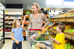 Young mother shopping with her two children
