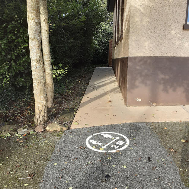 2 metre socially distanced ground markings.