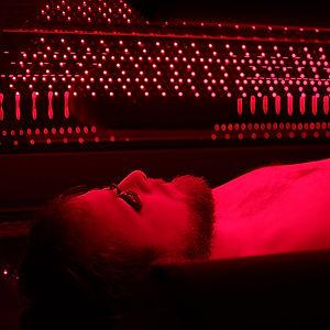 Man inside Thearpy Bed Red light.jpg
