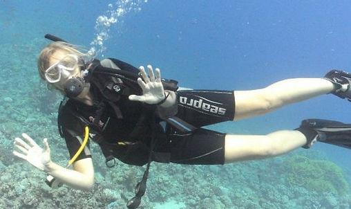An underwater photo of Mills Ross scuba diving.