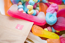An up close image of our Just Jelly range with our compostable and resealable pouch lying next to it
