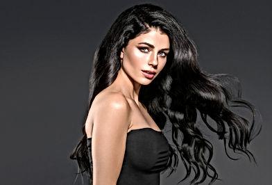 Woman dark brunette black hair. Curly Ha