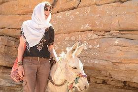 Fiona with runaway donkey, Oman.jpg