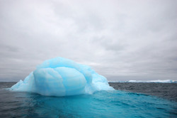 Iceberg and storm clouds.