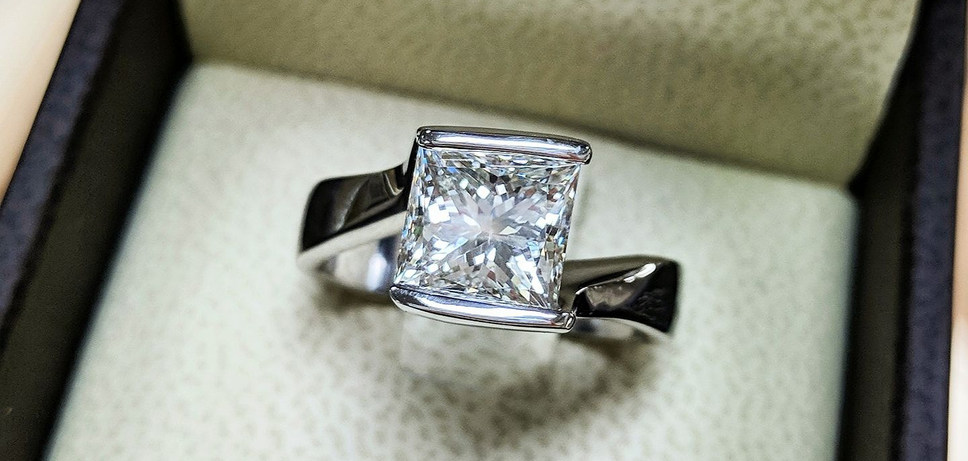 An almost impossible feat, this customer wanted their own custom design built around their 2 carat Princess cut Diamond. Harry truly outdid himself with this one!