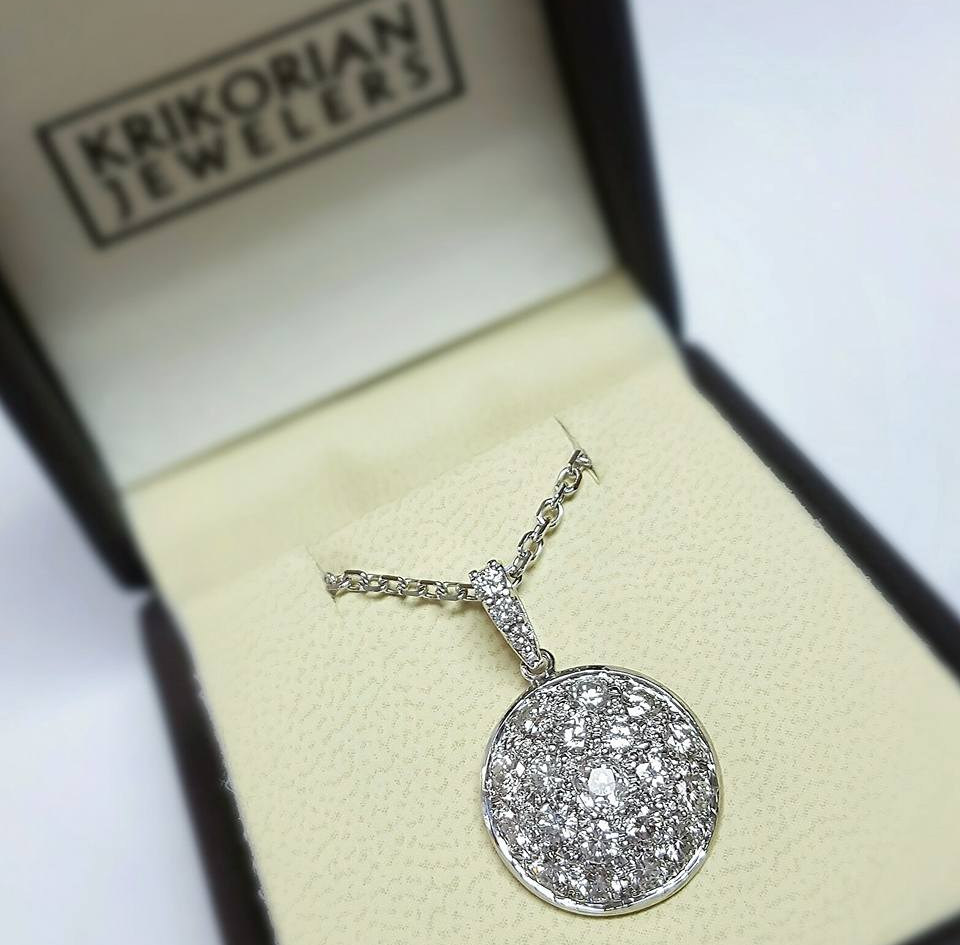What once was a pin became a stunning pendant after removing the back and adding a diamond bail!