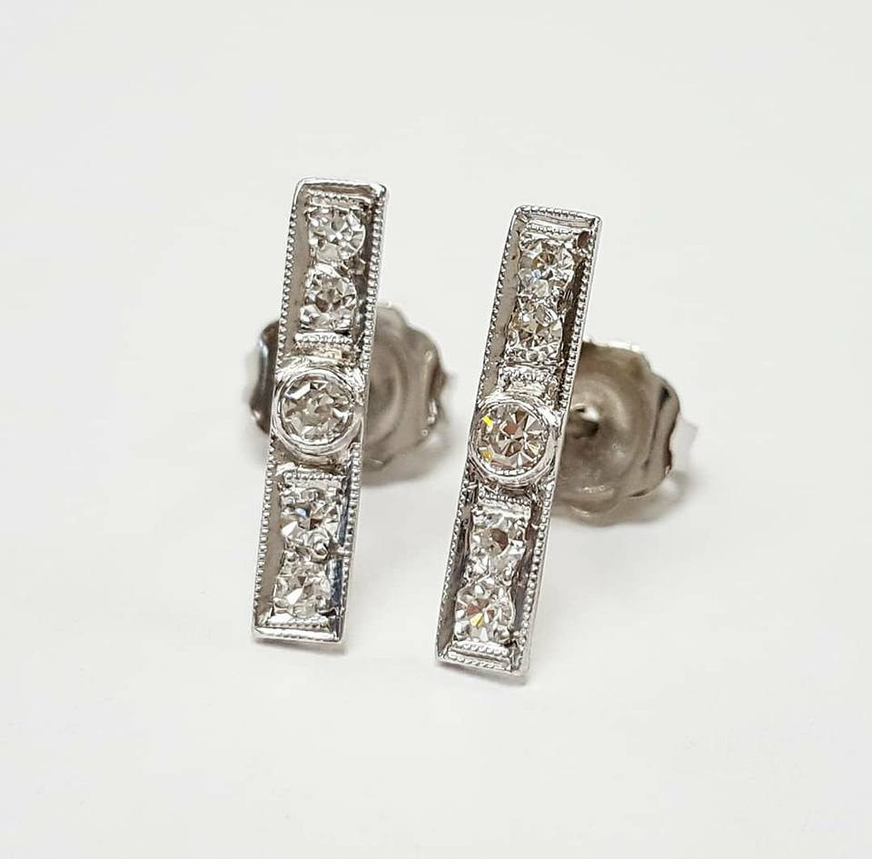 Tiny pieces from an Art deco watch band repurposed into lovely bar studs!