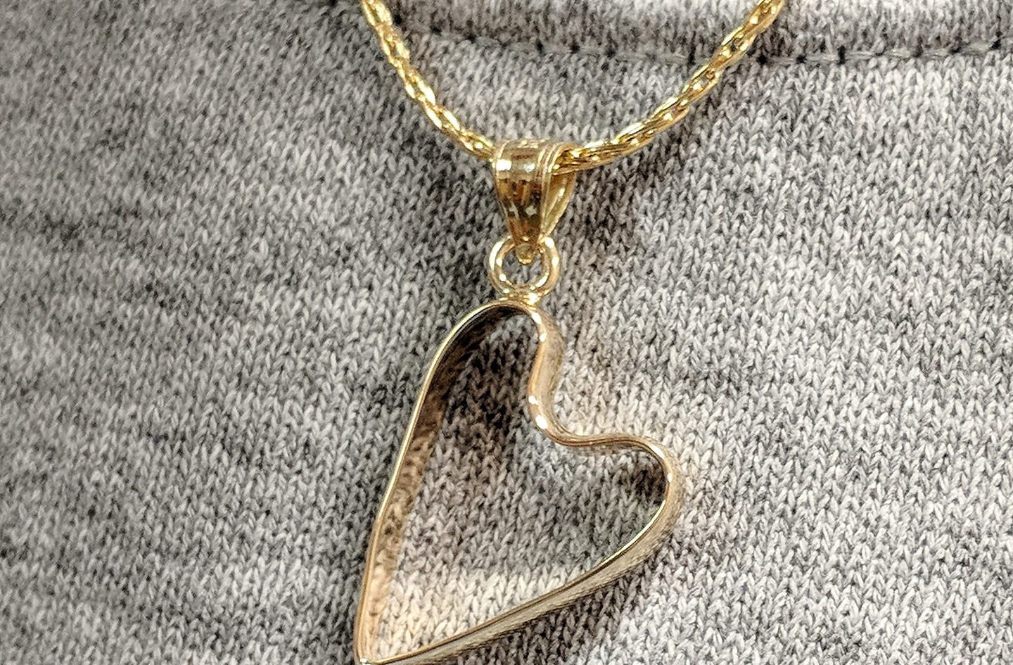 Sadly a customers husband passed away and she wanted a way to wear to his ring without having to take anything away from it. Harry came up with the idea of reshaping it into a heart and adding a bail to create a pendant. The customer absolutely loved it and now has a piece of her husband with her always.