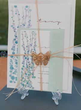 raffia tied rustic wedding invitation