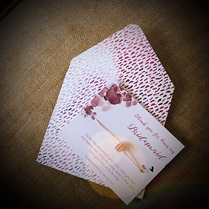 hand made envelope with a wedding wish bracelet which says 'thank you for being my bridesmaid'