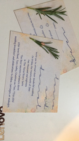 real sprigs of rosemary attached to invite