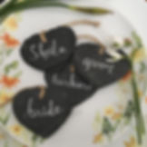 welsh slate hearts on a plate hand lettered with wedding guest's nams
