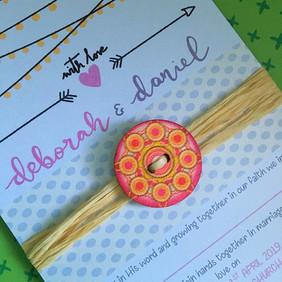 close up wooden button rustic invite