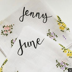 hand lettered vintage hankies to be used as wedding place cards / favours