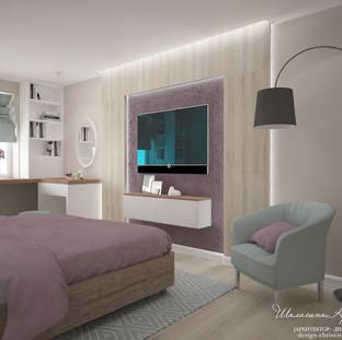 Интерьер спальни с рабочим местом и туалетным столиком