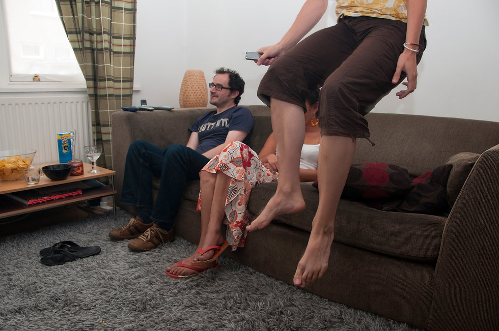 Woman leaps off settee in excitement whilst watching unseen TV